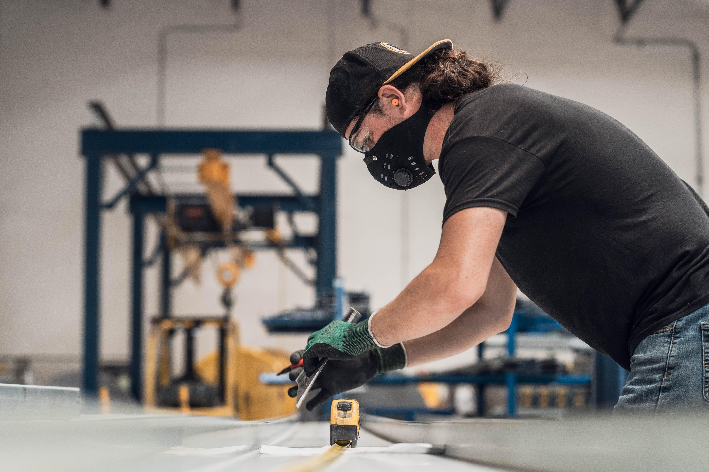 employee wearing mask at plant